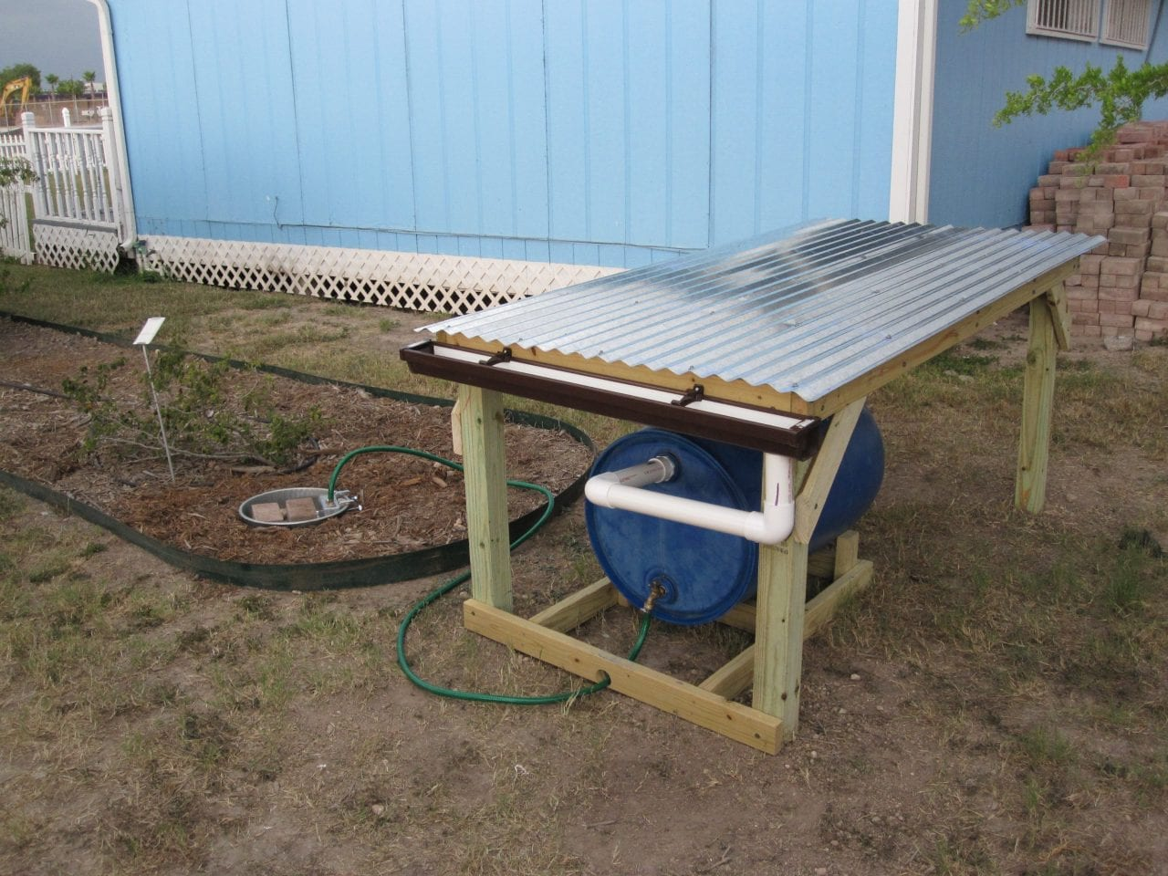 10 cool rainwater collection systems ready tribe for Pictures of rainwater harvesting system